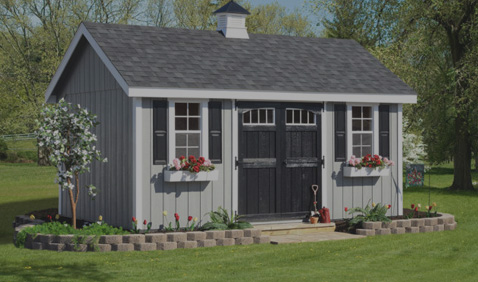 grey and black shed in lawn