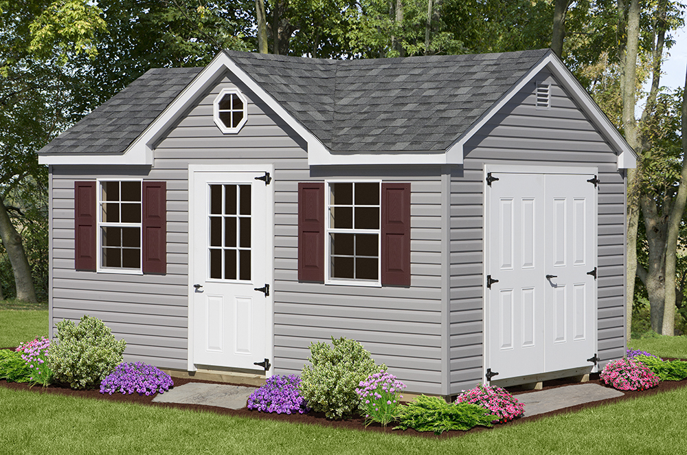 grey aframe shed with maroon shutters