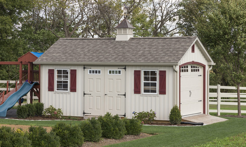 tan garden shed with maroon shutters