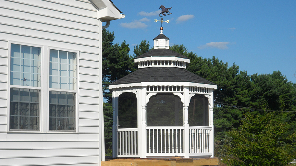 white vinyl octagon gazebo on deck