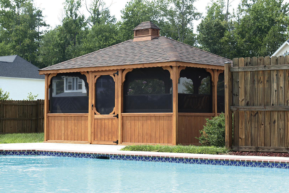 wooden gazebo with screens by pool