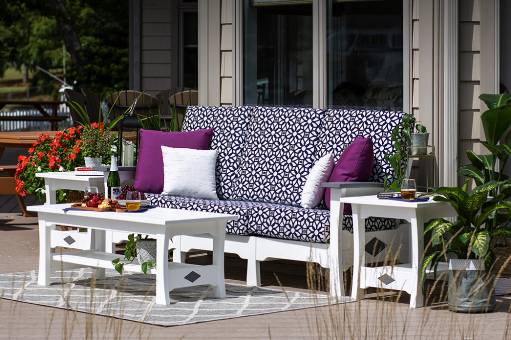 patterned chaise lounge with purple accent pillows