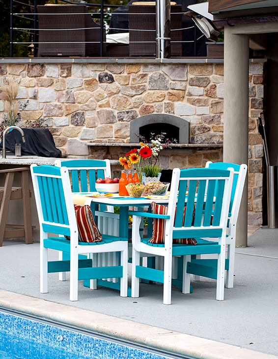 blue and white poly furniture by pool