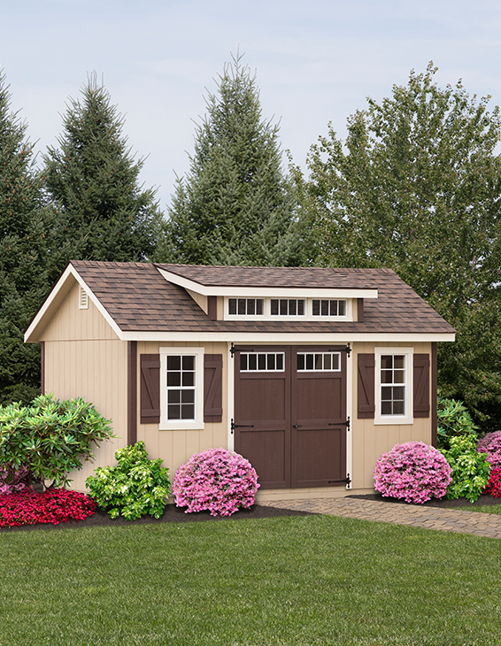 tan a-frame shed with brown shingles