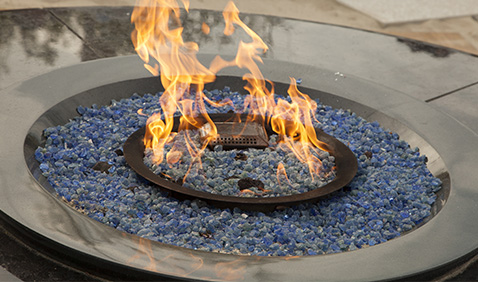 outdoor fireplace burning with blue fill